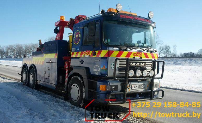 грузовой эвакуатор зимой